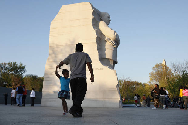 FILE - In this April 4, 2012 file photo, people visit the Martin Luther King, Jr. Memorial in Washington. Whether visitors want to try one of the first family�s favorite restaurants, discover a sense of history or escape from the crowd to find a museum off the beaten path, Washington is the nation�s cultural capital this weekend for inauguration visitors. (AP Photo/Jacquelyn Martin, File)