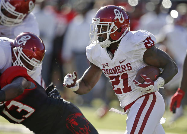 Oklahoma's Keith Ford (21) runs during a college football game between the University of Oklahoma Sooners (OU) and the Texas Tech Red Raiders at Jones AT&T Stadium in Lubbock, Texas, Saturday, November 15, 2014.  Photo by Bryan Terry, The Oklahoman