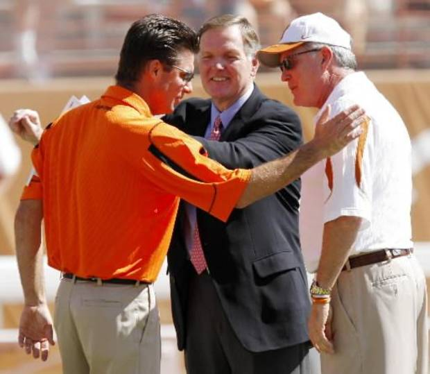 Mike Gundy greets Mack Brown before Oklahoma State University (OSU) plays the University of Texas (UT) at Darrell K. Royal-Texas Memorial Stadium at Joe Jamail Field in Austin, Texas on Saturday October 25, 2008. By Doug Hoke, The Oklahoman