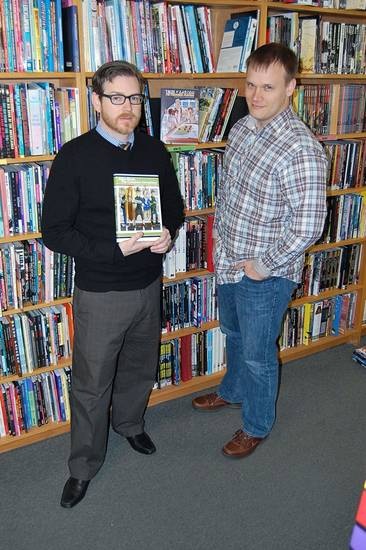 "Jeremy Short, left, and Aaron McKenny pose with the graphic novel ""Atlas Black.""  Short and McKenny's study indicates using graphics to impart information can increase recall.  Photo by Annette Price, for The Oklahoman. <strong></strong>"