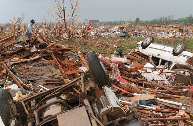 MAY 3, 1999 TORNADO: Tornado victims: Bill Paige looks over tornado damage in Moore off Western and 12th street.  Westmoore High School is in the background.