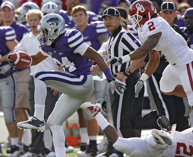 Kansas State Wildcats' Nigel Malone (24) runs an interception back past Oklahoma Sooners' Trey Franks (2) during the college football game between the University of Oklahoma Sooners (OU) and the Kansas State University Wildcats (KSU) at Bill Snyder Family Stadium on Saturday, Oct. 29, 2011. in Manhattan, Kan. Photo by Chris Landsberger, The Oklahoman  ORG XMIT: KOD