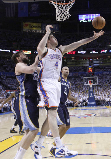 Oklahoma City's Nick Collison (4) grabs a rebound over Marc Gasol (33) of Memphisduring game five of the Western Conference semifinals between the Memphis Grizzlies and the Oklahoma City Thunder in the NBA basketball playoffs at Oklahoma City Arena in Oklahoma City, Wednesday, May 11, 2011. Photo by Sarah Phipps, The Oklahoman