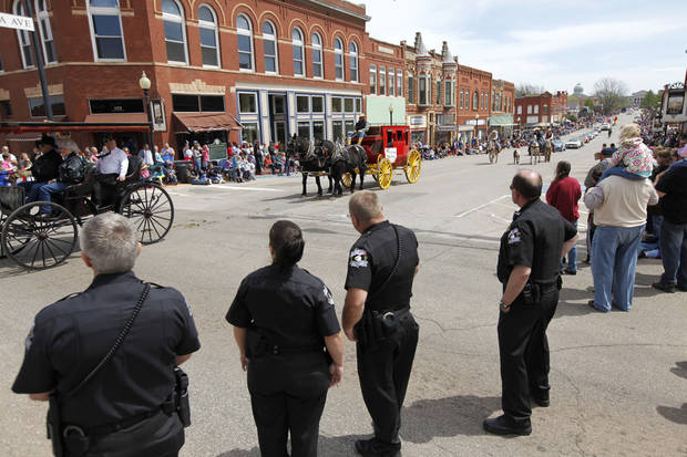 Oklahoma County Sheriff's Deputies watch the 89ers Day Parade in Guthrie, OK, Saturday, April 20, 2013,  By Paul Hellstern, The Oklahoman