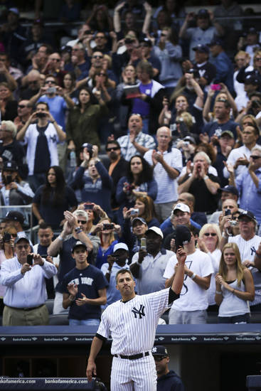 New York Yankees starting pitcher Andy Pettitte makes a curtain call after being relieved in the eight inning of a baseball game against the San Francisco Giants, Sunday, Sept. 22, 2013, in New York. (AP Photo/John Minchillo)