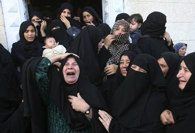 Palestinian women react during the funeral of Hisham Al Galban, a Hamas militant killed in an Israeli attack, in Khan Younis, southern Gaza Strip, Thursday, Nov. 15, 2012. Israel barraged the Gaza Strip with airstrikes and shelling Wednesday and killed the Hamas military chief in a targeted strike, launching a campaign aimed at stopping rocket attacks from Islamic militants. The assault killed 10 other Palestinians, including two children and seven militants. On Thursday, militant rockets fired into Israel killed three Israelis, raising the likelihood of a further escalation.(AP Photo/Eyad Baba) ORG XMIT: JRL135