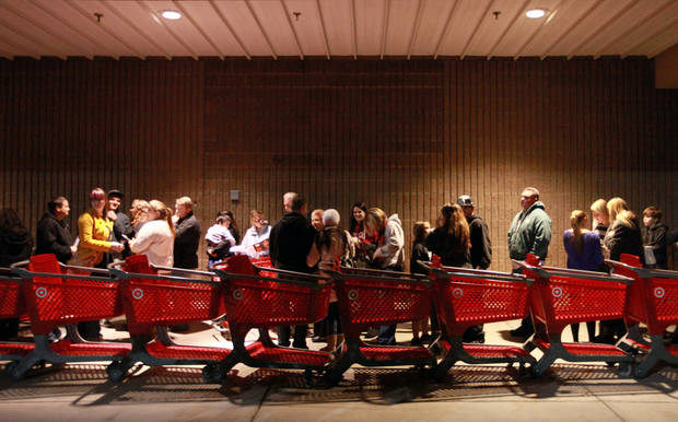 "A line forms in front of Target as they wait before its opening at 9 p.m. as shoppers took advantage of the sales and deals in the earlier shopping period for the typical ""Black Friday"" event on Thursday evening, Nov. 22, 2012 in Chico, Calif. (AP Photo/Jason Halley, Chico Enterprise-Record)"