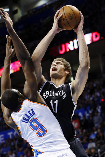 Brooklyn Nets center Brook Lopez (11) shoots over Oklahoma City Thunder forward Serge Ibaka (9) in the second quarter of an NBA basketball game in Oklahoma City, Wednesday, Jan. 2, 2013. (AP Photo/Sue Ogrocki)