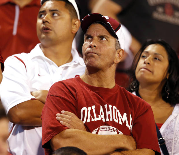 Fans watch the final minute on the clock at the college football game where the University of Oklahoma Sooners (OU) lost 24-19 to the Kansas State University Wildcats (KSU) at Gaylord Family-Oklahoma Memorial Stadium, Saturday, September 22, 2012. Photo by Steve Sisney, The Oklahoman