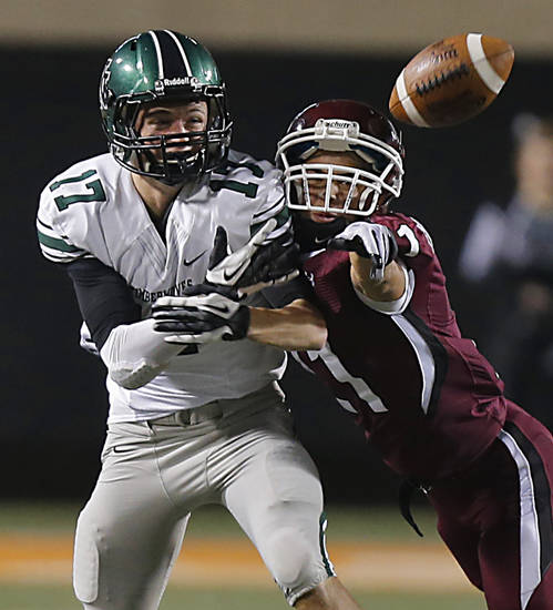 Jenks' Austin Casillas (21) breaks up a pass for Norman North's Channing Meyer (17) during the Class 6A Oklahoma state championship football game between Norman North High School and Jenks High School at Boone Pickens Stadium on Friday, Nov. 30, 2012, in Stillwater, Okla.   Photo by Chris Landsberger, The Oklahoman