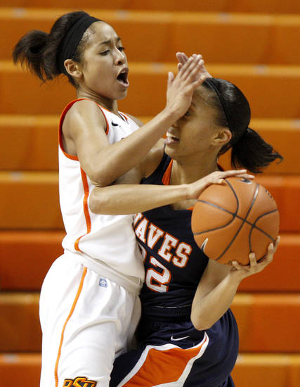 OSU's Tiffany Bias (3) defends Pepperdine's Lauren Bell (32) during a first-round NIT women's college basketball game between Oklahoma State University (OSU) and Pepperdine at Gallagher-Iba Arena in Stillwater, Okla., Wednesday, March 16, 2011. Photo by Bryan Terry, The Oklahoman