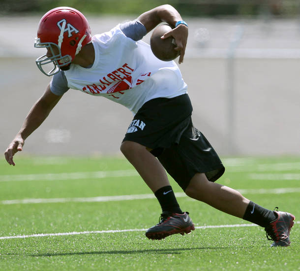 Cornerback Trez Jackson runs the ball upfield during drills at Carl Albert High School in Midwest City on on Tuesday, August 10, 2010. Photo by John Clanton, The Oklahoman