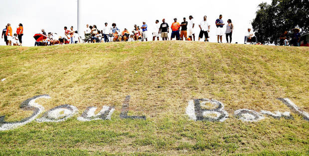 Fans line the top of the hill on the visitor's side at Millwood's  L.W. Good Stadium during the Soul Bowl football game  between the  Douglass Trojans and  the Millwood Falcons. Millwood defeated Douglass, 31-12.    Photo  by Jim Beckel, The Oklahoman. <strong>Jim Beckel - THE OKLAHOMAN</strong>