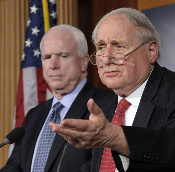 Senate Armed Services Committee Chairman Sen. Carl Levin, D-Mich., right, accompanied by the committee's ranking Republican, Sen. John McCain, R-Ariz., gestures during a news conference  on Capitol Hill in Washington, Friday, Dec. 28, 2012, to discuss changes in Senate procedural rules. (AP Photo/Susan Walsh)