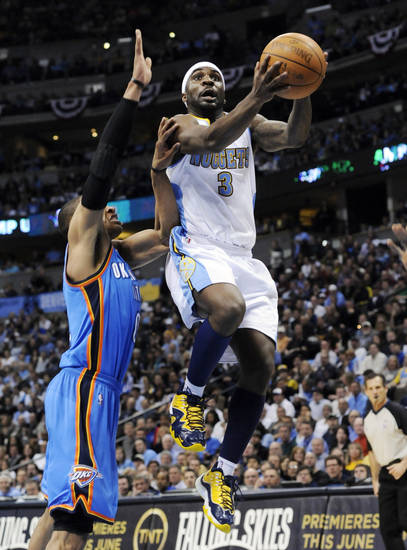 Denver Nuggets guard Ty Lawson (3) goes up for a shot against Oklahoma City Thunder guard Russell Westbrook (0) during the second half in game 4 of a first-round NBA basketball playoff series Monday, April 25, 2011, in Denver. (AP Photo/Jack Dempsey)  