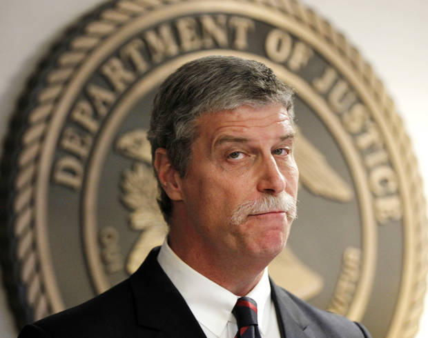 Jim Letten, U.S. Attorney for the Eastern District, announces his resignation during a news conference in New Orleans, Thursday, Dec. 6, 2012. Letten said his resignation is effective Dec. 11 and that he plans to stay on with the department briefly to help with the transition in leadership.(AP Photo/Gerald Herbert)