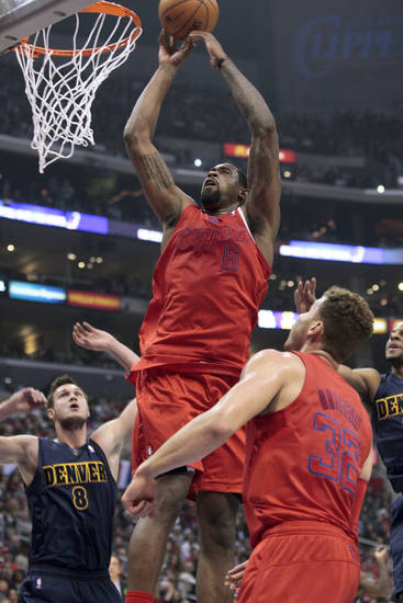 Los Angeles Clippers center DeAndre Jordan (6) drives to the hoop as Denver Nuggets' Danilo Gallinari (8) of Italy and the Clippers' Blake Griffin look ok during the first half of their NBA basketball game, Tuesday, Dec. 25, 2012, in Los Angeles. (AP Photo/Jason Redmond)