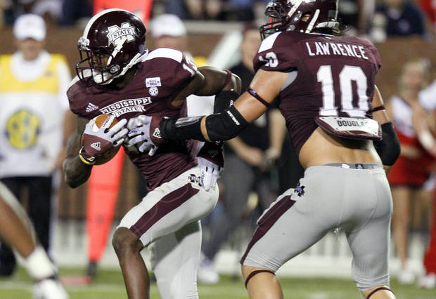 FILE - In this Sept. 22, 2012, file photo, Mississippi State defensive back Johnthan Banks (13) runs past the blocking of teammate linebacker Cameron Lawrence (10) after intercepting a pass in the fourth quarter of an NCAA college football game against South Alabama in Starkville, Miss. The backbone of No. 19 Mississippi State's success is a defensive secondary that's among the nation's most experienced. The starting four have combined for 37 career interceptions, including eight returned for touchdowns. (AP Photo/Rogelio V. Solis, File)