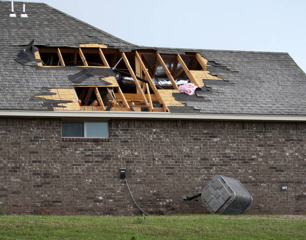 Damage to a home in the Thornbrook neighborhood after a tornado moved through Edmond, Okla., Sunday, May 19, 2013. Photo by Dave Fisk, for The Oklahoman