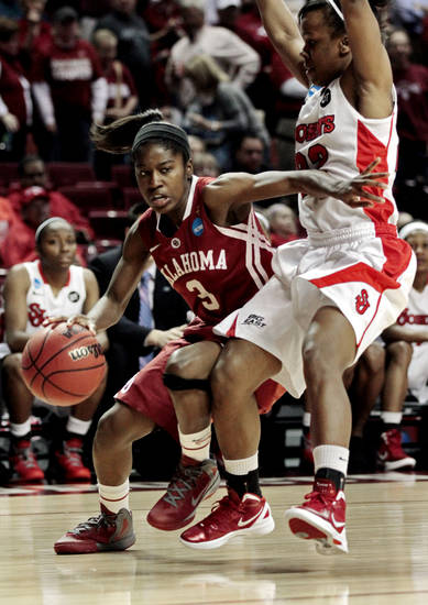 Oklahoma Sooners' Aaryn Ellenberg (3) tries to get by St. John's Red Storm's Eugeneia McPherson (22) as the University of Oklahoma Sooners (OU) play the St. John's Red Storm in the second round of the NCAA Women's Basketball Championship Tournament at the Lloyd Noble Center on Tuesday, March 20, 2012, in Norman, Okla.  
