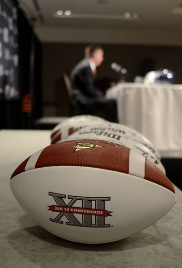 Big 12 football sit next to the podium as Oklahoma State head coach Mike Gundy answers questions during NCAA college football Big 12 Media Days, Monday, July 25, 2011, in Dallas. (AP Photo/Matt Strasen)