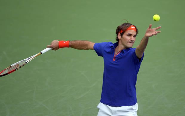 Roger Federer, of Switzerland, serves to Denis Istomin, of Uzbekistan, at the BNP Paribas Open tennis tournament, Saturday, March 9, 2013, in Indian Wells, Calif. (AP Photo/Mark J. Terrill)