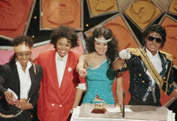 Michael Jackson accepted an award at the 1984 Grammy's with his sisters on stage (from left) Rebbie, Janet and La Toya Jackson (AP photo by