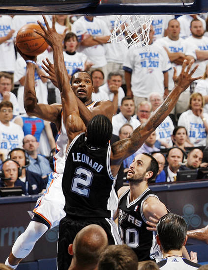 Oklahoma City's Kevin Durant (35) shoots against San Antonio's Kawhi Leonard (2) and Manu Ginobili (20) in the fourth quarter during Game 4 of the Western Conference Finals between the Oklahoma City Thunder and the San Antonio Spurs in the NBA playoffs at the Chesapeake Energy Arena in Oklahoma City, Saturday, June 2, 2012. Oklahoma City won, 109-103. Photo by Nate Billings, The Oklahoman