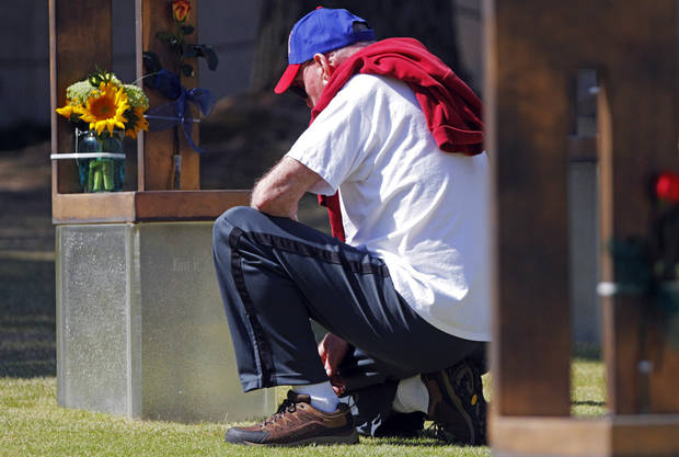 Larry Dillow pauses for a moment to remember his daughter Kim Cousins at the 19th anniversary Remembrance Ceremony at the Oklahoma City National Memorial Saturday morning, April 19, 2014, to honor the memory of the 168 victims killed in the 1995 bombing of the Murrah Federal Building. Photo by KT King, The Oklahoman