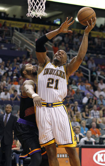 Indiana Pacers forward David West (21) attempts a basket as he is guarded by Phoenix Suns forward Markieff Morris, left, during the first half of an NBA basketball game, Saturday, March 30, 21013, in Phoenix. (AP Photo/Paul Connors)