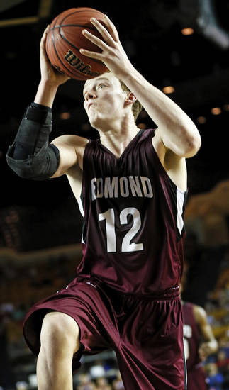 Edmond Memorial's Tyler Holcomb (12) takes the ball to the hoop during a Class 6A boys high school basketball game in the semifinals of the state tournament at the Mabee Center in Tulsa, Okla., Friday, March 8, 2013. Edmond Memorial beat Owasso, 53-50, in double-overtime. Photo by Nate Billings, The Oklahoman