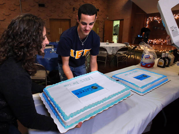 University of Oklahoma students Rebekah Martin and Jake Fuller set out cakes at the Hillel foundation's Latkas for Love annual fundraiser on Thursday, Nov. 29, 2012, in Norman, Okla.  