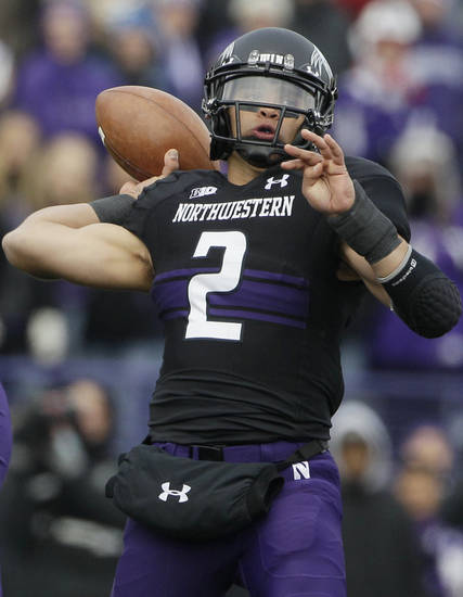 Northwestern quarterback Kain Colter (2) throws a pass during the first half of an NCAA college football game against Illinois in Evanston, Ill., Saturday, Nov. 24, 2012. (AP Photo/Nam Y. Huh)