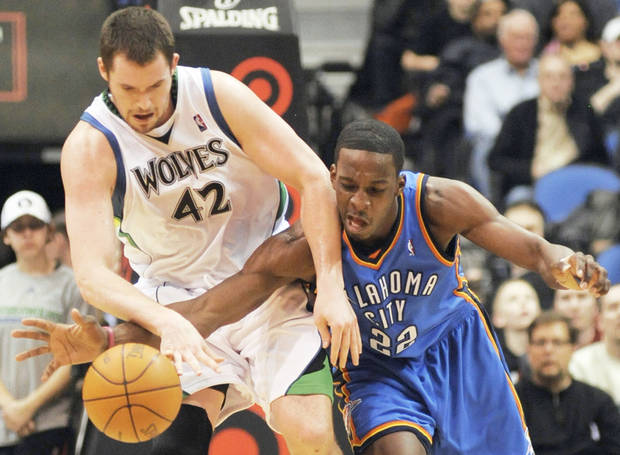 Thunder forward Jeff Green, right, and Minnesota's Kevin Love chase after a loose ball during Oklahoma City's 109-107 win Sunday. AP PHOTO