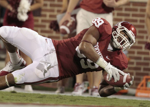 Oklahoma's Austin Haywood tries to stretch to the end zone during the Sooners' game vs. Missouri on Saturday in Norman. Photo by Steve Sisney, The Oklahoman