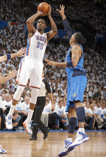 Oklahoma City's Kevin Durant (35) shoots over Dallas' Shawn Marion (0) during Game 2 of the first round in the NBA basketball playoffs between the Oklahoma City Thunder and the Dallas Mavericks at Chesapeake Energy Arena in Oklahoma City, Monday, April 30, 2012. Photo by Sarah Phipps, The Oklahoman