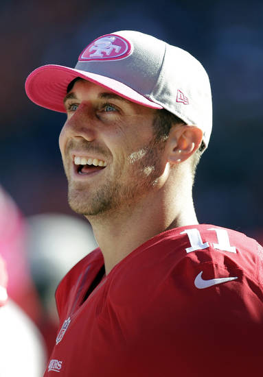 San Francisco 49ers quarterback Alex Smith smiles on the sideline during the fourth quarter of an NFL football game against the Buffalo Bills in San Francisco, Sunday, Oct. 7, 2012. The 49ers won 45-3. (AP Photo/Tony Avelar)