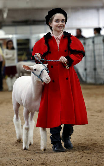 Meaghan Coats, 10, of Noble, leads her lamb in a round of competition on Thursday.