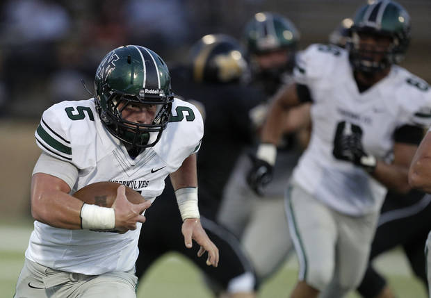 Beau Proctor (5) runs the ball during a high school football game between Midwest City and Norman North in Midwest City, Friday, Sept. 21, 2012.  Photo by Garett Fisbeck, The Oklahoman