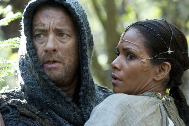 "This film image released by Warner Bros. Pictures shows Tom Hanks as Zachry and Halle Berry as Meronym in a scene from ""Cloud Atlas,"" an epic spanning centuries and genres. The film is an epic of shifting genres and intersecting souls that features Tom Hanks, Halle Berry, Jim Broadbent, Hugh Grant, Hugo Weaving, Ben Whishaw, Jim Sturgess, James D�Arcy, Doona Bae, Keith David, Sarandon and others in multiple roles spanning the centuries. (AP Photo/Warner Bros. Pictures, Jay Maidment)  ORG XMIT: NYET268"