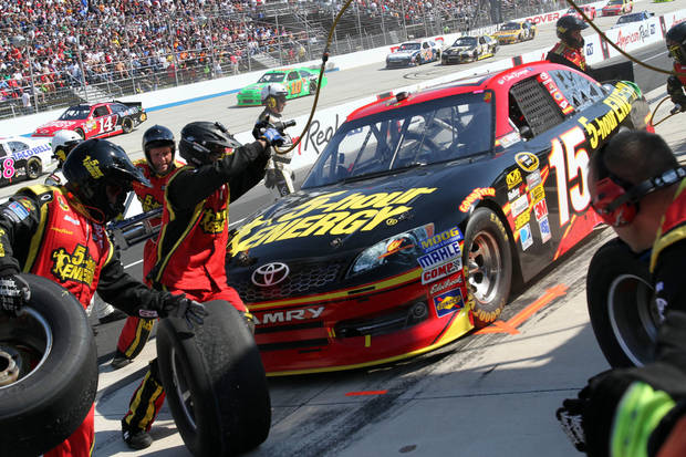 Clint Bowyer's crew works on the car during a pit stop in the NASCAR Sprint Cup Series auto race Sunday, Sept. 30, 2012, at Dover International Speedway in Dover, Del. (AP Photo/The News-Journal, Daniel Sato) NO SALES