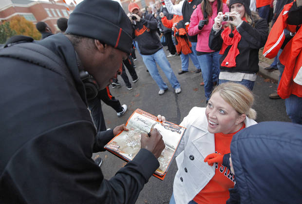 Heidi Wilburn reacts as she gets an autograph from Justin Blackmon in the &#039;Spirit Walk&#039; before the Bedlam college football game between the Oklahoma State University Cowboys (OSU) and the University of Oklahoma Sooners (OU) at Boone Pickens Stadium in Stillwater, Okla., Saturday, Dec. 3, 2011. Photo by Chris Landsberger, The Oklahoman