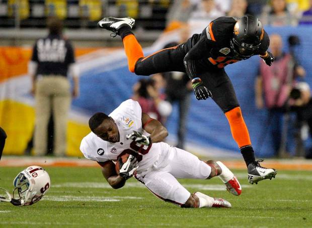 Oklahoma State's Markelle Martin (10) tackles Stanford's Ty Montgomery (88)during the Fiesta Bowl between the Oklahoma State University Cowboys (OSU) and the Stanford Cardinals at the University of Phoenix Stadium in Glendale, Ariz., Monday, Jan. 2, 2012. Photo by Sarah Phipps, The Oklahoman