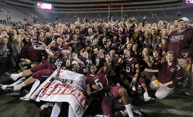 The Jenks' Trojans celebrate the win over Norman North during the Class 6A Oklahoma state championship football game between Norman North High School and Jenks High School at Boone Pickens Stadium on Friday, Nov. 30, 2012, in Stillwater, Okla.   Photo by Chris Landsberger, The Oklahoman