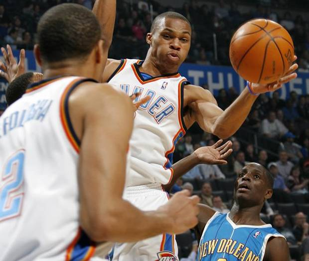 Oklahoma City's Russell Westbrook (0) passes the ball in the direction of Thabo Sefolosha (2) as Darren Collison of New Orleans looks on during the NBA basketball game between the New Orleans Hornets and the Oklahoma City Thunder at the Ford Center in Oklahoma City, Wednesday, March 10, 2010. Photo by Nate Billings, The Oklahoman ORG XMIT: KOD