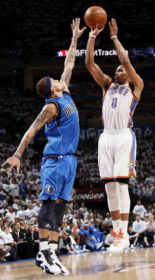 Oklahoma City's Russell Westbrook (0) takes a shot over Dallas' Delonte West (13) during Game 2 of the first round in the NBA basketball  playoffs between the Oklahoma City Thunder and the Dallas Mavericks at Chesapeake Energy Arena in Oklahoma City, Monday, April 30, 2012.  Oklahoma City won, 102-99. Photo by Nate Billings, The Oklahoman