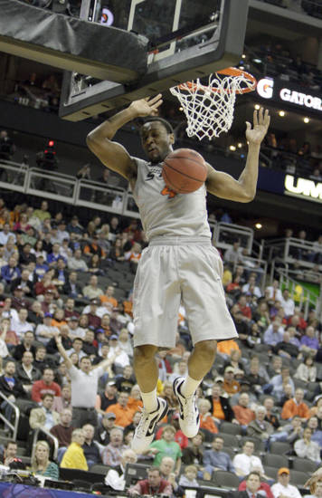 Oklahoma State's Brian Williams (4) dunks the ball during the Big 12 tournament men's basketball game between the Oklahoma State Cowboys and the Texas Tech Red Raiders at the Sprint Center, Wednesday, March, 7, 2012. Photo by Sarah Phipps, The Oklahoman