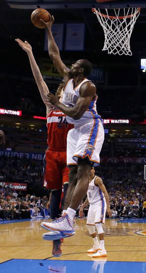 Oklahoma City's Serge Ibaka (9) blocks the shot of Washington's Jan Vesely (24) during an NBA basketball game between the Oklahoma City Thunder and the Washington Wizards at Chesapeake Energy Arena in Oklahoma City, Wednesday, March 19, 2013. Oklahoma City won 103-80. Photo by Bryan Terry, The Oklahoman