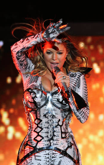 FILE - In this Sept. 30, 2010, file photo, Stacy Ferguson, known as Fergie, of the Black Eyed Peas, performs during a concert in Monterrey, northern Mexico. (AP Photo/Carlos Jasso, file) ORG XMIT: NYET771