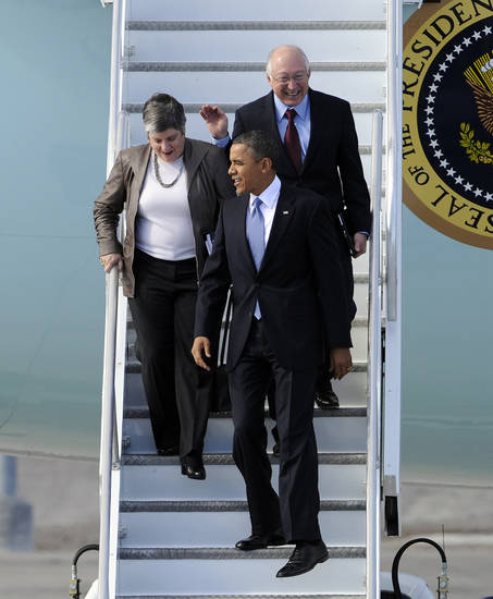 President Barack Obama exits Air Force One with Secretary of Homeland Security Janet Napolitano and Secretary of the Interior Ken Salazar upon his arrival at McCarran International Airport Tuesday, Jan. 29, 2013 in Las Vegas. (AP Photo/David Becker)